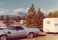 1975 Chevrolet El Camino in Colorado with 13 foot camper with matching blue stripe